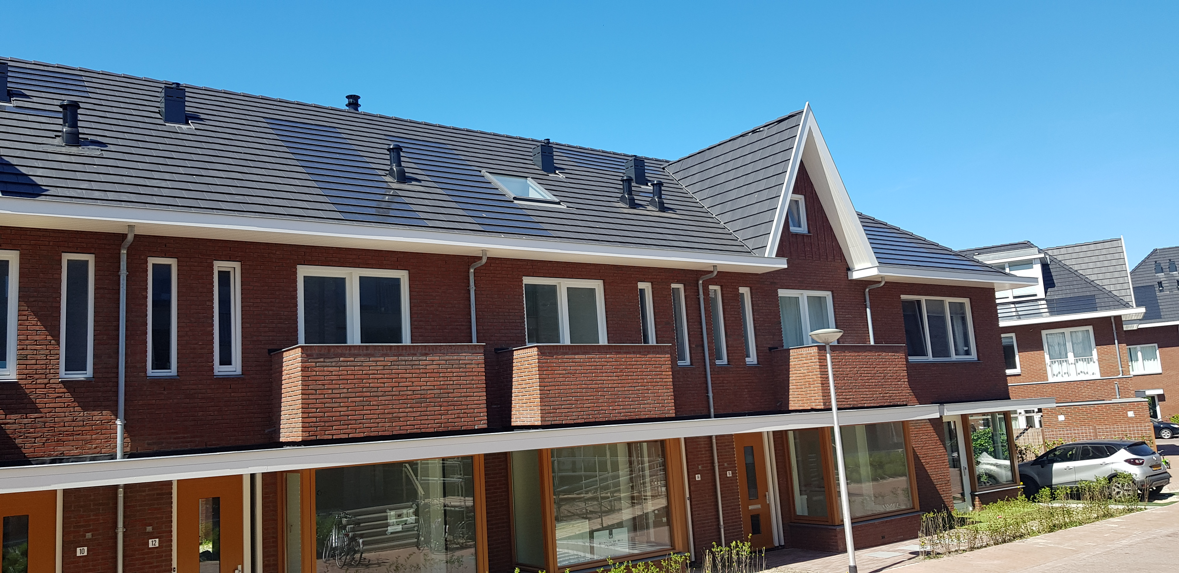 Mystique solar roof tiles on row houses